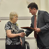Danvers: Pat Toomey, left, is honored for her service to the town of Danvers by Selectmen Daniel Bennett.  photo by Mark Teiwes /  Salem News