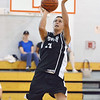 Danvers: Ipswich player Lou Galanis makes a layup against St. John's Prep.  photo by Mark Teiwes / Salem News.