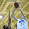 Danvers: Danvers center George Merry puts up a shot defended by Salem's Antonio Reyes. photo by Mark Teiwes  / Salem News