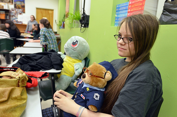 Salem: Jamie Gallant sits with her teddy bear during an all night session of readings banned books. photo by Mark Teiwes / Salem News