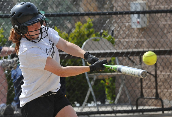 Beverly: At the Courtney Corning Memorial Softball Tournament  Bishop Fenwick's Kim Shinnick makes contact with the ball. photo by Mark Teiwes / Salem News