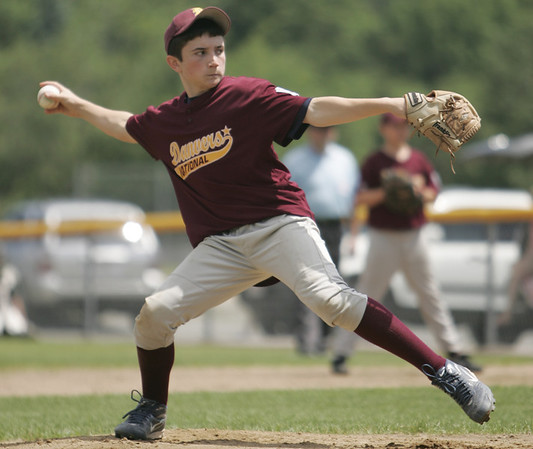 Danvers:  Danvers National Little League pitcher Jack Anderson takes aim for a strike in a District 15 game against Groveland. photo by Mark Teiwes / Salem News