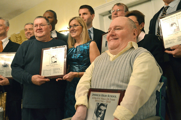 Ipswich: Celebrated Ipswich High historian John Thomas, right, poses with other hall of fame inductees.  Joe Robishaw, left, and Nancy Simmons, center, hold the plaque for their father Jojo Robishaw, class of '41 football player.  photo by Mark Teiwes / Salem News