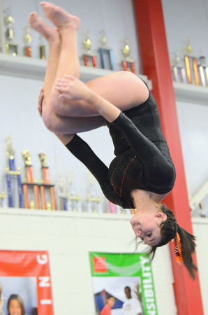 Beverly: Beverly High School junior Taylor Metta flips at the end of her beam routine.  photo by Mark Teiwes / Salem News