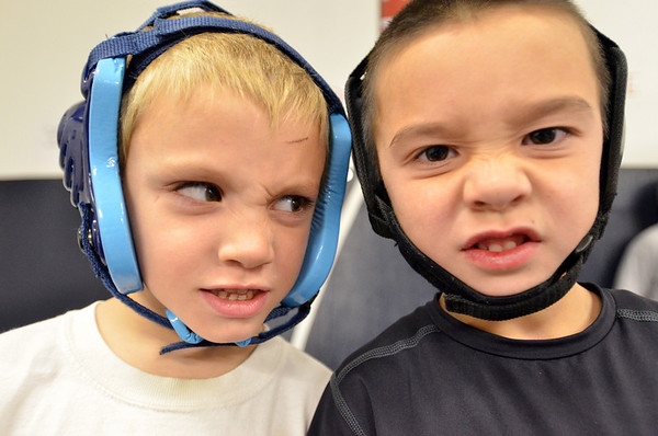 Danvers: 5-year-old Cord Vallis of Boxford, left, and Alex Schaeublin of Salem, 5, are ready to wrestle with their headgear on. photo by Mark Teiwes / Salem News