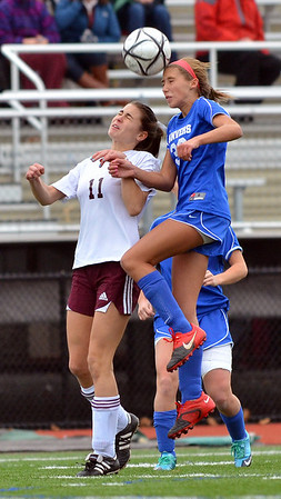 Lynn: Danvers freshman Delaney Zecha wins a header.   Danvers controlled the ball for the majority of the game but lost in a final shootout.  photo by Mark Teiwes / Salem News