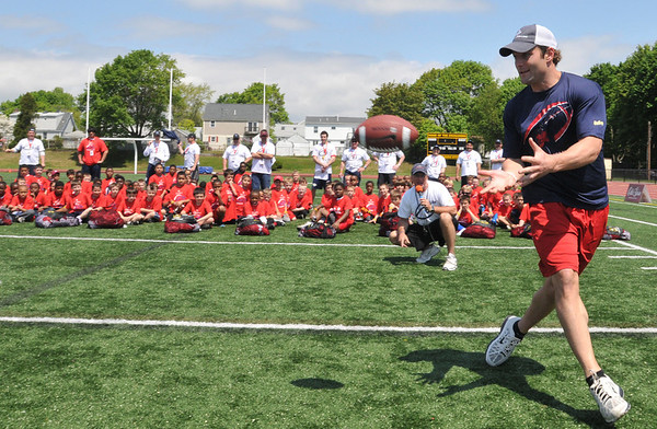 Peabody:  West Welker makes a catch at his football camp at Bishop Fenwick High School.    photo by Mark Teiwes / Salem News