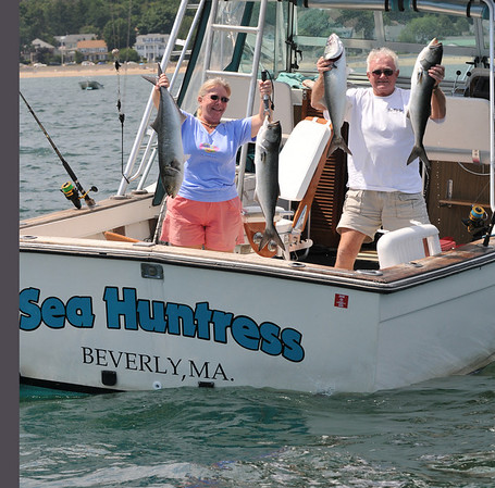 Beverly: Wanda Crosby, left, and John Morrison show off 4 of the fish they caught on Sunday.  John said that he followed circling birds to find a bluefish run.   photo by Mark Teiwes / Salem News
