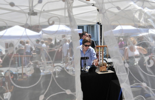 Beverly:  Bridget Keown takes a look at the jewelry at one of the many vendors during Arts Fest Beverly.  photo by Mark Teiwes / Salem News