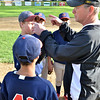 Salem: Indians coach Ed Schaejbe talks with the infielders during a game.  The team won the championship last year's champions.  photo by Mark Teiwes / Salem News