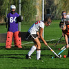Marblehead High School field hockey player Gretchen Rowe, left, attacks the goal area closely defended by Beverly's Aly Shea. photo by Mark Teiwes / Salem News