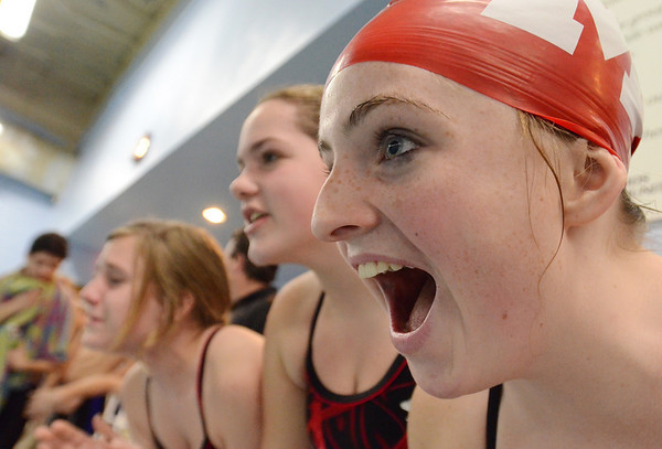 Salem: Masconomet High School swimmers Kelsey McAlarney, right, Kelsey Giovannicci, and Lauren Veo cheer for their teammates during a meet against Hamilton-Wenham.  photo by Mark Teiwes  / Salem News