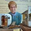 "Wenham:  "" Miniaturist"" Nancy Shane stands behind two of her creations, an Aero II trailer and a Wenham Lake roadside stand. photo by Mark Teiwes / Salem News"