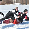 Marblehead: A group of Marblehead High School football players gathered on Superbowl Sunday at Gatchell playground for some snow football.  Tyler Shepard tackles Justin Burnett, right. photo by Mark Teiwes  / Salem News