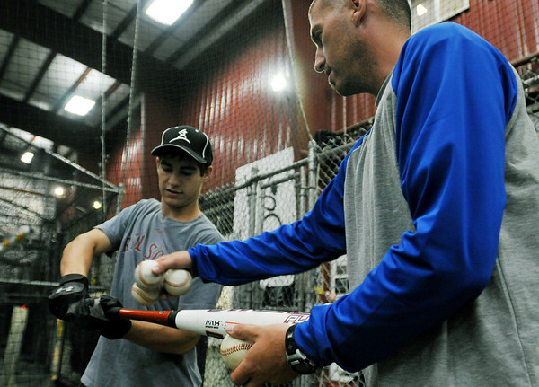 Middleton: Jon Cahill, right, talks over hitting mechanics with Casey Orlando of Saugus.  photo by Mark Teiwes / Salem News