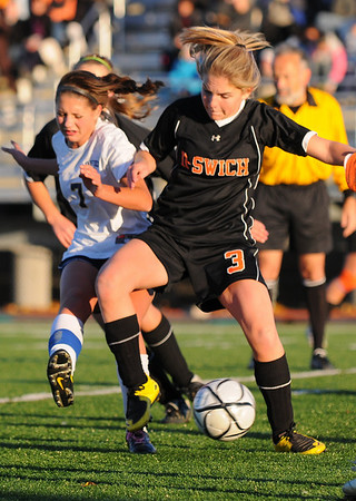 Lynn: Ipswich's Grace Gardner, right, battles to steal the ball from Lynnfield's Tori Copelas during Thursday's division 3 north semifinals.  Ipswich won the match in a shootout after two overtime periods. photo by Mark Teiwes / Salem News