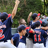 Beverly:  Peabody West celebrates their win over Beverly West in the District 15 Little League championship game  Mark Teiwes / Salem News