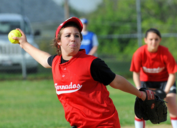 Salem: Tornados pitcher Samantha Mento throws a fastball into the strike zone. Photo by Mark Teiwes / Salem News