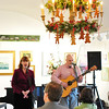 Marblehead: At the Marblehead Arts Association, Jane Fallon and Steve Rapson sing a duet at a holiday sing along concert with twelve musicians singing both original and traditional songs.  The proceeds benefit the charity SmallCanBeBig.org.   photo by Mark Teiwes / Salem News