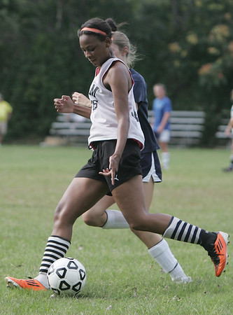 Salem: Salem High's Alix Bryant speeds around a Hamilton-Wenham defender.  photo by Mark Teiwes /  Salem News