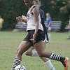 Salem: Salem High's Alix Bryant speeds around a Hamilton-Wenham defender.  photo by Mark Teiwes /  Salem News