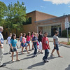Peabody: On the first day of school, Dr. Thomas Cornacchio, West Memorial School principal, talks with a fifth grade class on their way to recess.    photo by Mark Teiwes / Salem News