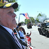 Swampscott: Raymond Harris of Swampscott watches the Veterans Appreciation Day parade with his wife Rosalie (not pictured).  Their daughter Jennifer Harris was killed in Iraq in 2007. photo by Mark Teiwes / Salem News