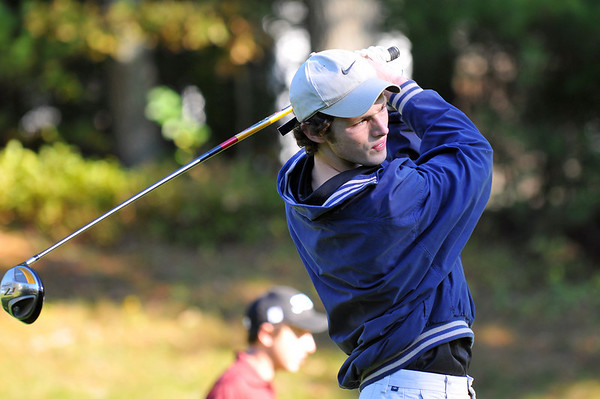 Ipswich:  Ipswich High School golfer Mark Gallant is ranked first on the team.   He watches a drive after teeing off during a match against Rockport and Manchester-Essex.  photo by Mark Teiwes / Salem News