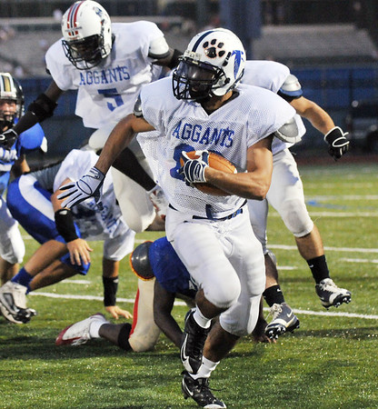 Lynn: Lawrence's Francis Nova sprints upfield during a kickoff return at the 49th annual Agganis All-Staff Football Classic.  photo by Mark Teiwes / Salem News