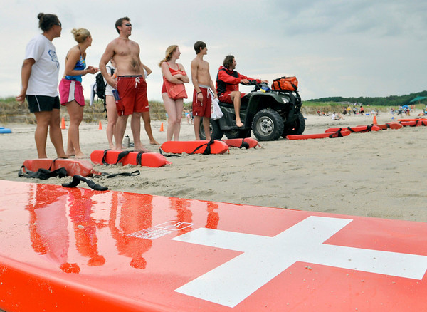 Ipswich: The life guard crew at Crane Beach stand together at the end of their first day back to work. photo by Mark Teiwes / Salem News