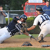 Danvers: St. John's Prep player Brandon Bingel, left, slides home safe past Danvers catcher Joe Strangie.  photo by Mark Teiwes / Salem News