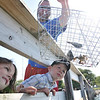 Maddie Carter, left, wanted to celebrate her sixth birthday going crabbing at the Salem Willows for the first time with her brother Mason, 4, and father Pete of Beverly.  Photo by Mark Teiwes / Salem News