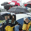 Beverly: John and Jeri Erickson, right, huddle under an umbrella as they cheer for their son Peter, a Endicott College lacrosse player in the team's 16-7 win over Gordon College  photo by Mark Teiwes / Salem News