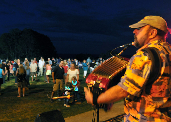 Iswich: Rockin' Ralph Tufo plays cajun and zydeco music on the accordion with his band the Squeezebox Stompers for dancers at Castle Hill .  photo by Mark Teiwes / Salem News