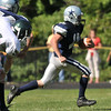 Hamilton: Hamilton-Wenham's Trevor Lyon gains big yardage with a quarterback keeper on a run that led to a touchdown on the next play. photo by Mark Teiwes  / Salem News