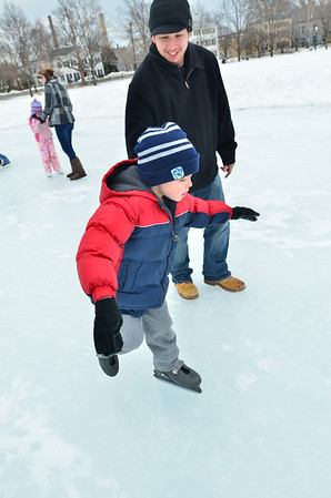 Salem:  7-year-old Alex Diefen of Salem skates along closely followed by Dana, his dad at the Salem Common's ice skating rink. photo by Mark Teiwes / Salem News