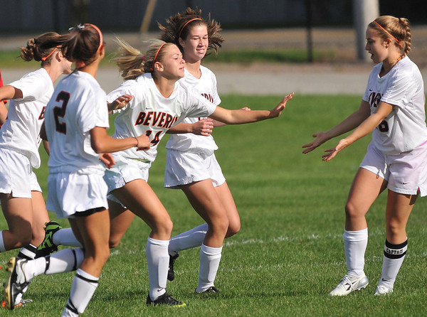 Beverly: Beverly's Eva Goudeau (14), center, celebrates with her team after scoring early in a game against Salem.   photo by Mark Teiwes  / Salem News