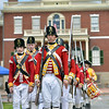Ken Mental, left, of Mendon, Nicholas Federico of Wilmington and Tim Lee of Lexington stand in formation with their British reenactment unit encamped on Derby Wharf. Photo by Mark Teiwes/ Salem News.