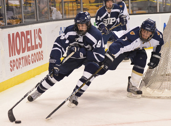 Boston: St. John's Prep forward John Farrow loops from around the Malden Catholic goal.   photo by Mark Teiwes / Salem News