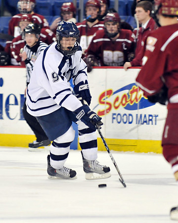 Lowell:  St. John's Prep player Jon Farrow carries the puck building an attack.  photo by Mark Teiwes / Salem News