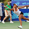 Danvers: Boston Lobsters tennis player Raquel Kops-Jones leaps to reach the ball.  Kops-Jones has ten ITF doubles titles.  photo by Mark Teiwes / Salem News