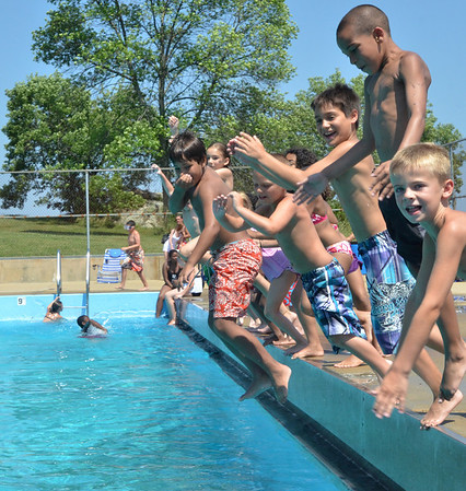Salem: Kids from the Salem Boys and Girls club jump back into the water after the Forest River Pool was cleared for a life guard rotation.  photo by Mark Teiwes / Salem News