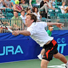 Danvers: Boston Lobsters tennis player Eric Butorac reaches for the ball at the home opening match of the season.    photo by Mark Teiwes / Salem News
