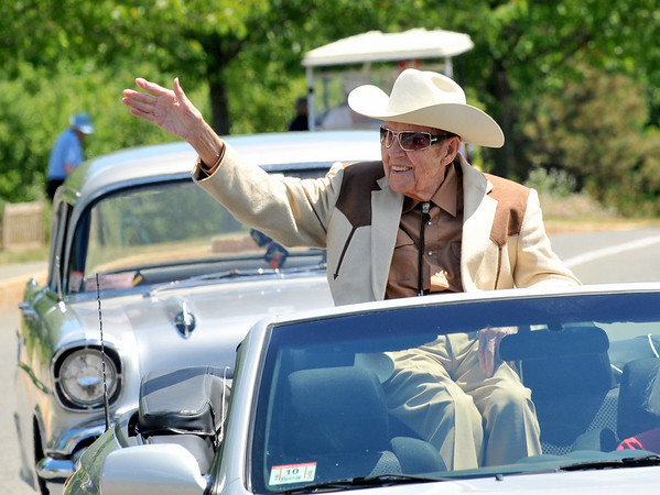 Peabody: Rex Trailer, New England television icon, waves to Brooksby Village residents at a parade on Thursday celebrating the 4th of July. photo by Mark Teiwes / Salem News