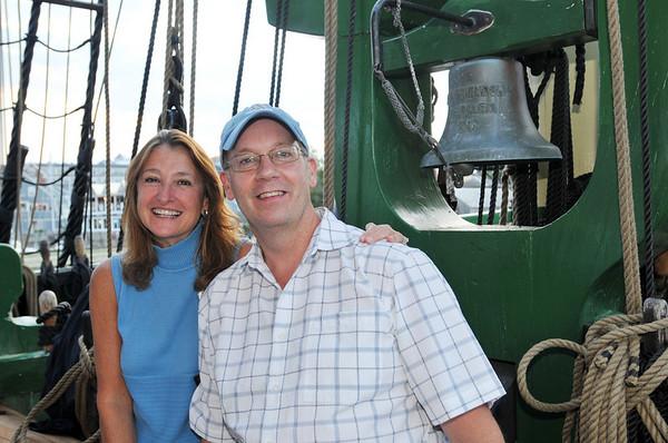 Salem: Mary Ellen Halliwell, left, and Paul Falconer both from Salem enjoy a beautiful summer night aboard the Friendship.  photo by Mark Teiwes / Salem News