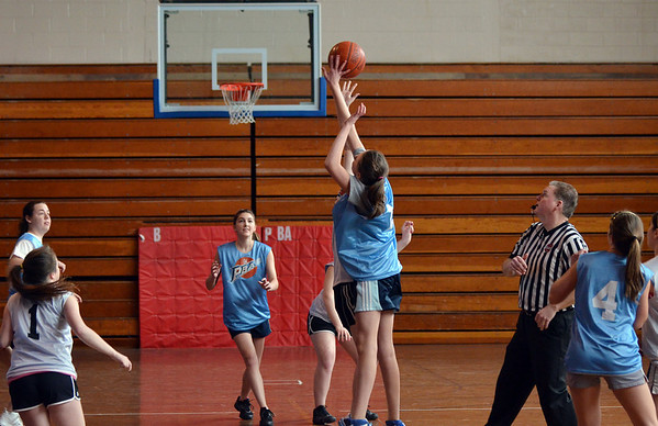 Peabody: 14 year old girls Peabody Basketball Association teams play in playoffs at Higgins Middle School.  photo by Mark Teiwes / Salem News