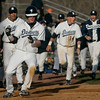 Danvers: Danvers captain Greg Little celebrates as he comes home scoring the winning run in the team's 2-1 win over Swampcott.  photo by Mark Teiwes / Salem News