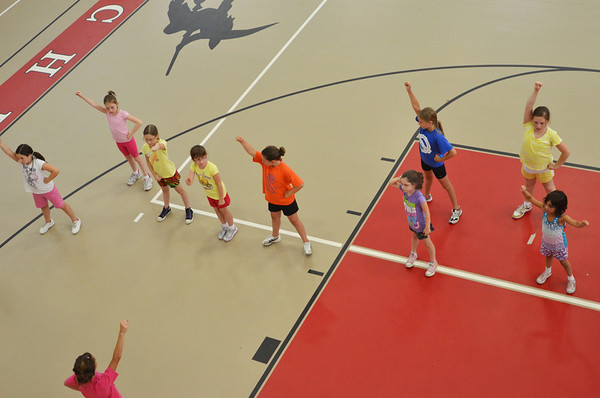Salem: Girls participate in the Salem youth cheerleading clinic.  photo by Mark Teiwes / Salem News