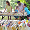 Ipswich: From left, Hannah Ciarametaro, 12, her sister Aly, 8, mother Tina, and sister Zoe, 10, browse through the many books at a sale outside the Heard House Museum.  Tina was looking for medieval period books.  photo by Mark Teiwes / Salem News