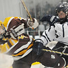 North Andover: St. John's Prep player Shane Eiserman puts a hard check on Weymouth's Corey Tuplin in the Prep's 5-1 win. photo by Mark Teiwes / Salem News